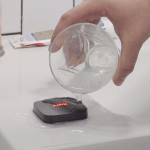 Water Pouring on Ajax Wireless Alarm Fob